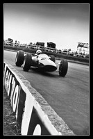 John Surtees 1964 world Champoin in third place  British Grand Prix 1965